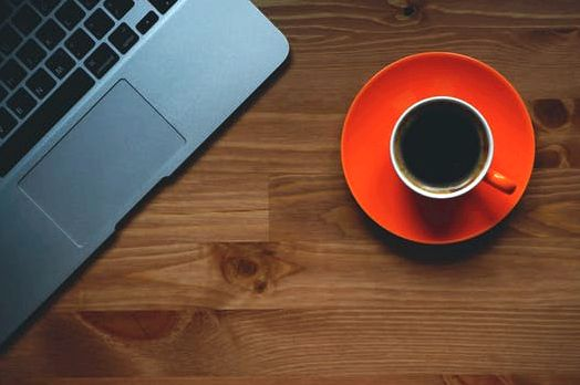Black Coffee Filled in White Ceramic Mug on Orange Plate