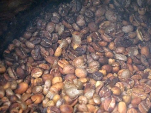 coffee beans turning brown in the middle of roasting process
